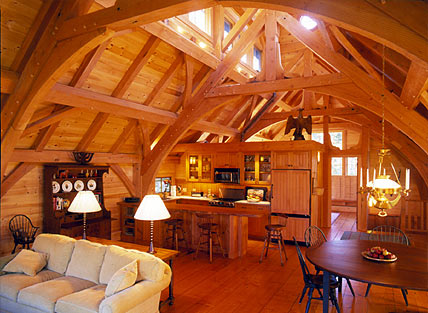 Post and beam home construction timber frame home and for Cheap barn style homes